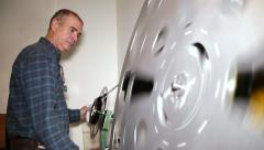 Film Technician Rewinding 35mm Film Stock Footage