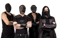Photo of the metal band in masks - stock photo