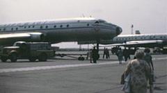 Kiev 1970s: people reaching aircrafts in the runway of Boryspill airport Stock Footage
