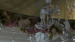 Close-up of crystal chandelier swayed Stock Footage