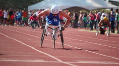 Paralympic games.Wheelchair. Runners. Track. Games Stock Footage