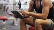 Stock Video Footage of young man with tablet pc computer in gym