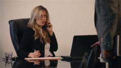 Business meeting. Female boss talking on the phone. Male worker coming in office - stock footage