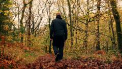 Man Walks Down Path In Woods Stock Footage