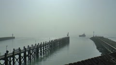 Jetty at the entrance of the harbor Stock Footage