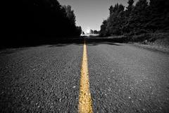 Empty road with Yellow Dividing line at Night - stock photo