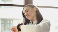 Woman with mobile phone and smart watch in the office HD Arkistovideo