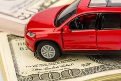 Car on dollar bills Stock Photos