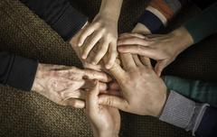 Many hands together - stock photo