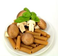 Baby Bella mushrooms, pasta and basil - stock photo