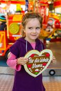 child with gingerbread heart. mother's day - stock photo