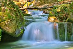 Nice small waterfall on mountain river Stock Photos