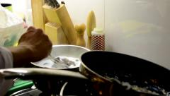 Chef prepares food - dessert - chef adds chocolate to pot (dirty pan) Stock Footage