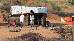 Indian poor family and a shack in the Thar Desert. Pushkar, India - stock footage