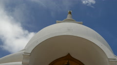 Tilt from the Japanese Peace Pagoda to buddha statue in Galle, Sri Lanka - stock footage