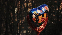 """Stock Video Footage of Heart-Shaped Ballons With Caption """"I Love You"""" and Picture of Teddy Bear Are"""