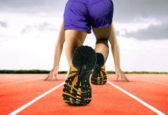 man feet on running track - stock photo