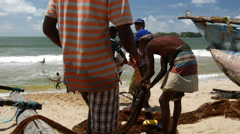 Fishermen pulling the nets to the shore in Galle, Sri Lanka Stock Footage