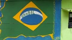 Different Types of Brazil flag painted on the wall in Bahia, Brazil Stock Footage