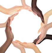 Conceptual symbol of multiracial human hands making a circle Stock Photos