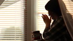 Woman near a window Stock Footage