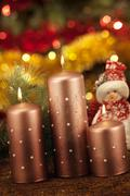 Candles with christmas decorations in atmospheric light Stock Photos