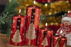 candles with christmas decorations in atmospheric light - stock photo