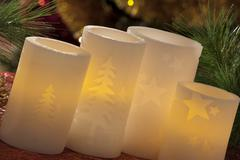 Electric candles with christmas decorations in atmospheric light Stock Photos