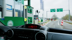 Driving through toll station Stock Footage
