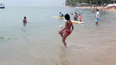 Girl Playing Football in the Praia do Forte in Bahia, Brazil Stock Footage