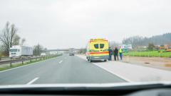 Ambulance on emergency lane on highway Stock Footage