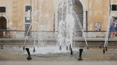 Water from a fountain in the city center of Matera, South of Italy Stock Footage