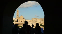 Silhouette of tourist people enjoying in Italian old city Matera:  cherish,  Stock Footage