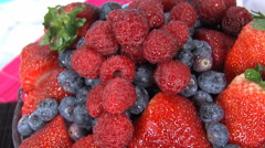 Studio shot of raspberries, blueberries and strawberries with sugar. Stock Footage