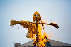 traditional off winter in russia, burning effigies of carnival. - stock photo
