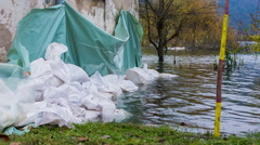 Sand bags around the house walls saving from flood Stock Footage
