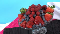 Studio shot of raspberries, blueberries and strawberries. Stock Footage