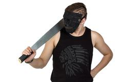 Photo of the young man in mask with hatchet Stock Photos