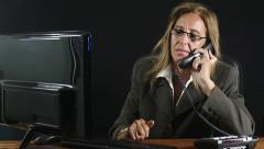 tired business woman having problem at work; stressed answering at the phone - stock footage