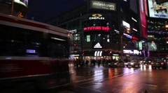 Toronto Yonge and Dundas intersection at night Stock Footage