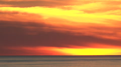 Vivid Ocean Clouds at Sunset Real Time Stock Footage