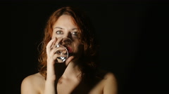 lonely and depressed woman drinking wine in the darkness; alcoholism, addicted - stock footage