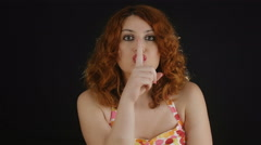 Do silence: young woman indicate silence with finger over her lips Stock Footage