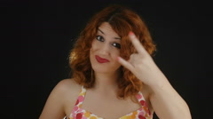 young and beautiful woman is making superstitious gesture: gesture of the horns - stock footage