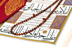 Muslim rosary beads on the Holy Quran Stock Photos