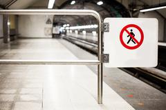 Safety Interdiction Sign (Do not Cross) on a Subway Platform - stock photo