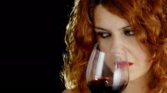 Young woman tastes red wine and drinks: alcohol, good wine, glass Stock Footage
