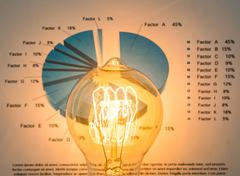 Light bulb with business graph Kuvituskuvat