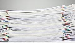 Pile of paperwork place on finance account Stock Photos