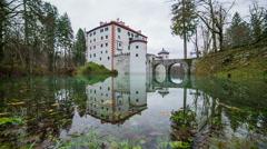 Castle Sneznik sliding over lake Stock Footage